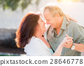 Middle Aged Couple Enjoy A Romantic Slow Dance Outside 28646778
