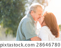 Middle Aged Couple Enjoy A Romantic Slow Dance and Kiss Outside 28646780