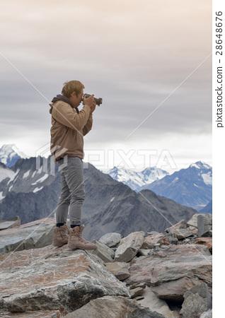 Man at snowcapped mountain peak, Mount Cook, NZ 28648676