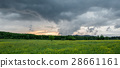 Dramatic sky over green nature fields 28661161