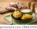 Baked potatoes with bacon, cheese and parsley. 28662098