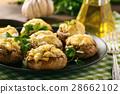 Baked mushroom caps stuffed with creams cheese. 28662102