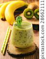 Banana and kiwi smoothie on dark wooden background 28662111