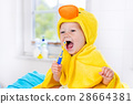Baby in bath towel with tooth brush 28664381