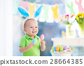Baby with bunny ears on Easter egg hunt 28664385