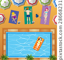 People relaxing at swimming pool 28668231