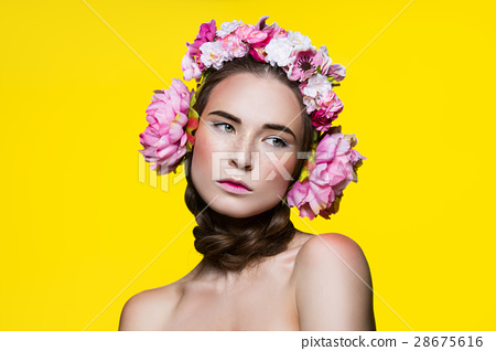 Beautiful girl with floral headphones 28675616
