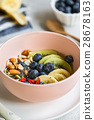 Varieties of fruits and nuts on Greek yogurt 28678163