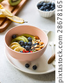 Varieties of fruits and nuts on Greek yogurt 28678165