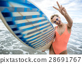 Blonde with surfboard on beach 28691767