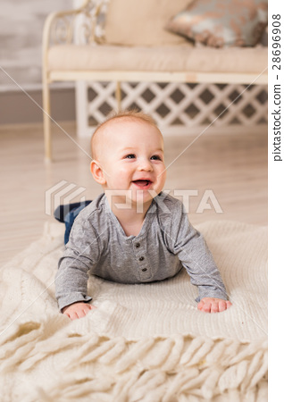 Laughing Baby Boy Lying On Tummy At Home 28696908