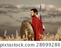 Muscular medieval warrior standing in the field 28699286