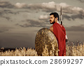 Muscular medieval warrior standing in the field 28699297