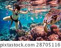 Snorkeler Maldives Indian Ocean coral reef. 28705116