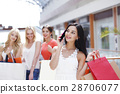 Shopping woman talking on the phone 28706077