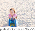 happy Asian child on a seesaw in sunset light 28707555