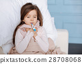 Little ill girl measuring temperature 28708068