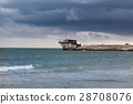 Coast in Italy at stormy weather with Trabucco 28708076