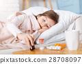 Sick little girl taking pills 28708097