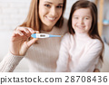 Cheerful mother and daughter feeling happy after 28708436