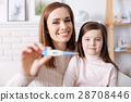 Cheerful mother feeling happy after her child 28708446