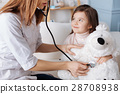 Professioal doctor examining fluffy toy 28708938