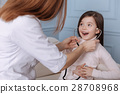 Positive cute little girl playing with stethoscope 28708968