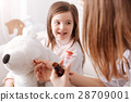 Professional doctor giving pills to little girls 28709001
