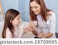 Cheerful doctor giving pills to little girl 28709005