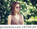 Beautiful Woman in Pink Sunglasses in Spring 28709185