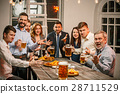Group of friends enjoying evening drinks with beer 28711529