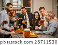 Group of friends enjoying evening drinks with beer 28711530