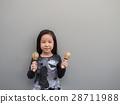 Little asian child play the maracas 28711988