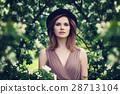 Beautiful Young Woman in the Garden  28713104