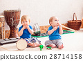 Boys with musical instruments 28714158