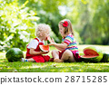 Kids eating watermelon in the garden 28715285