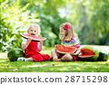 Kids eating watermelon in the garden 28715298