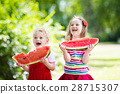 Kids eating watermelon in the garden 28715307