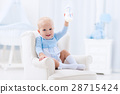 Baby boy with bottle drinking milk or formula 28715424