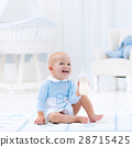 Baby boy with bottle drinking milk or formula 28715425