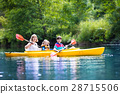 Family enjoying kayak ride on a river 28715506