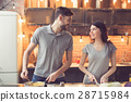 Young couple cooking in kitchen 28715984