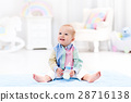 Baby boy with bottle drinking milk or formula 28716138