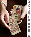 Fortune teller showing vintage tarot cards 28731033