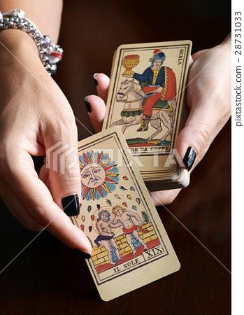 Fortune teller showing vintage tarot cards 28731033