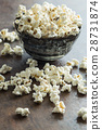 Popcorn in ceramic bowl. 28731874