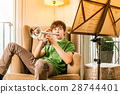 Playing the trumpet at home 28744401