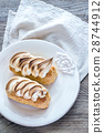 Eclairs with lemon curd and meringue 28744912