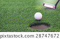 Golf ball dropping into the hole 28747672