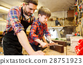 boy and dad with calipers measure wood at workshop 28751923